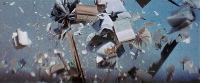 Scene from Zabriskie Points with books exploding